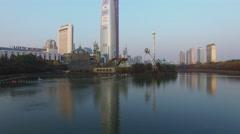 Lotte World amusement park on lake not far from skyscraper Stock Footage