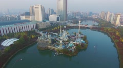 City panorama with Lotte World amusement park on lake Stock Footage