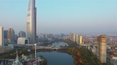 Cityscape with Lotte World amusement park on lake and skyscraper Stock Footage
