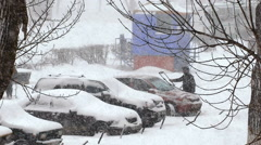 Heavy snowfall in the city. snow covered cars in the parking lot Stock Footage