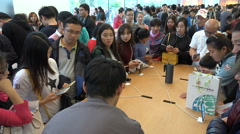 Customers visit busy Apple store in shopping street Shanghai, China Stock Footage