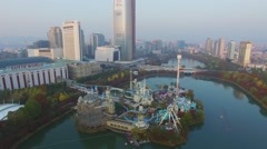 Lotte World amusement park on pond not far from Lotte Tower skyscraper Stock Footage
