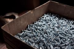 Box with large number of furniture screws Stock Photos