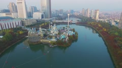 Townscape with Lotte World amusement park on lake and skyscraper Stock Footage