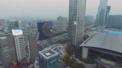 Cityscape wit street traffic at autumn evening. Aerial view Stock Footage