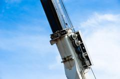 Stock Photo of Heavy industrial pulley and cable assembly on crane