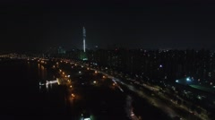 Cityscape with traffic on highway at autumn night. Aerial view Stock Footage