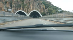 Approaching and driving into tunnel on the E90 in Sicily, Italy. Stock Footage