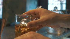 Bartender mixing alcohol and poured into a cocktail glass in the bar, 4k - stock footage
