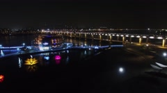 Illuminated buildings on Hangang river near Banpodaegyo bridge Stock Footage