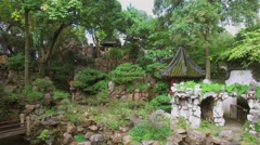 Ancient style buildings among stones in Yuyuan Garden at autumn Stock Footage