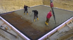 Construction worker when concreting a foundation base slab construction Stock Footage