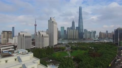 Coastal city with many skyscrapers and Oriental Pearl TV Tower Stock Footage