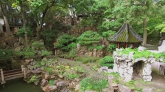 Old style buildings among stones in Yuyuan Garden at autumn Stock Footage