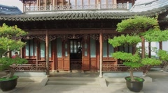 Asian ancient style building in Yuyuan Garden and cityscape Stock Footage