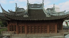 Facade with entrance to Asian ancient style edifice at sunny day Stock Footage