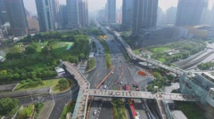 Highway traffic near Lujiazui Park among skyscrapers at autumn Stock Footage