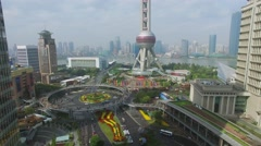 Road traffic on roundabout not far from Oriental Pearl TV Tower Stock Footage