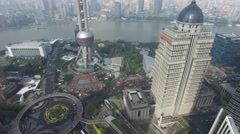 City panorama with Oriental Pearl TV Tower and Lujiazui Park Stock Footage