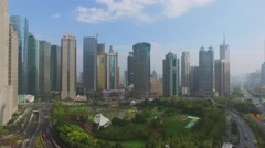 Cityscape with Lujiazui Park among skyscrapers at autumn Stock Footage