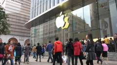 Facade of an Apple Store in busy Nanjing shopping street in Shanghai, China Stock Footage