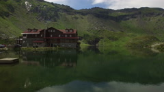 Aerial view over Balea Lake Cabin in Transfagarasan, Fagaras Mountains, Romania. Stock Footage