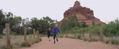 Slow Motion Boys Running and Jumping on a Hiking Trail Stock Footage