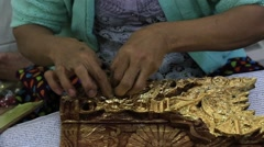 Stock Video Footage of Burmese women are coated with gold wooden souvenirs, Myanmar. Burma