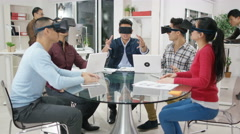 4K Computer programmers trying out virtual reality viewers Stock Footage
