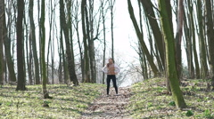 Sexy girl running in the woods. Slow motiom - stock footage