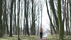 Sexy girl running in the woods. Slow motiom Stock Footage