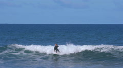 People surfing at a beach along the Great Ocean Road in Australia Stock Footage
