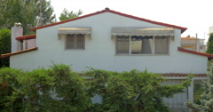 View on house with white wall and red roof Stock Footage