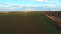 Aerial view to fields and road. 4k - stock footage