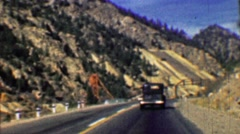 1958: Interstate highway 70 two lane road past mining tailings. Stock Footage