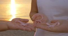 Women with pink awareness ribbons outdoor at sunset Stock Footage