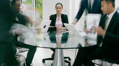 4K Time lapse busy corporate business group working, woman sits frozen in time Stock Footage