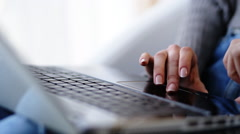 Close up of female hands typing a message or correcting a text on her laptop - stock footage
