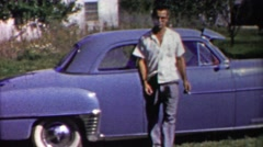1958: Calm collected handsome man walking carefully from blue car. Stock Footage