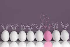 Pink bunny among white rabbits as Easter eggs - stock photo