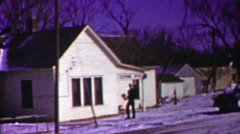 1958: Navy delivery man brings package from telephone office winter snow. - stock footage