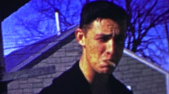 1958: Rebelous teenage sneaking smoking cigar rooftop hideway. Stock Footage