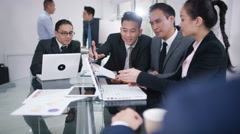 4K Asian corporate business group in discussion in business meeting Stock Footage
