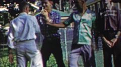 1958: Teenage boys hazing friend wrestling him into submission. Stock Footage