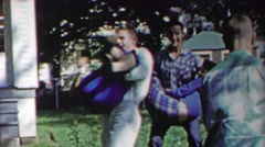 1958: Teenages carry girlfriends while old people pose for photo. Stock Footage