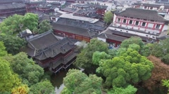 National style buildings and pond in Yuyuan Garden at autumn Stock Footage