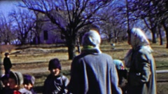 1958: Country schoolyard kids gather playground rural lifestyle. Stock Footage