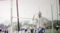 1958: Teenage boys practice high jump sports technique leaping. Stock Footage