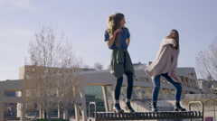 Teen Girls Practice Dance Moves On City Park Bench On Sunny Spring Day Stock Footage