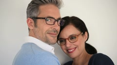 Middle-aged couple with eyeglasses on white background Stock Footage